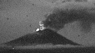Night-time shot of the ash cloud of the Popocatépetl volcano