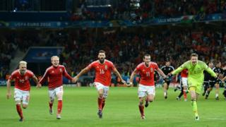 Wales players celebrate after the UEFA Euro 2016, quarter final match at the Stade Pierre Mauroy, Lille