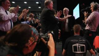 Jeremy Corbyn being greeted on stage after finishing his leader's speech