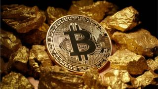 A Bitcoin and gold nuggets