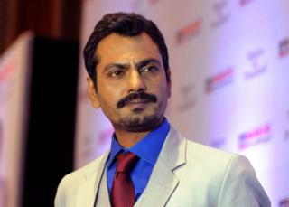 Indian Bollywood actor Nawazuddin Siddiqui poses at the press conference announcing him as new ambassador of Mayur Suitings in Mumbai on October 6, 2015