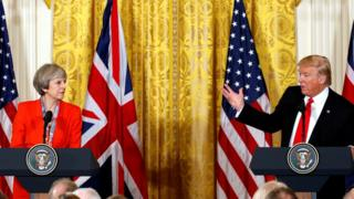 British Prime Minister Theresa May listens as U.S. President Donald Trump speaks during their joint news conference at the White House in Washington, U.S., January 27, 2017.