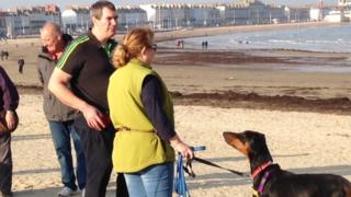 Dog owners on Weymouth beach