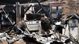 General view of a destroyed home whitegoods following bushfire damage on November 13