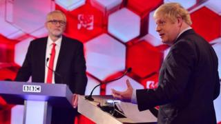 Boris Johnson and Jeremy Corbyn stand at their podiums
