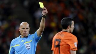 Robin van Persie of Netherlands gets yellow card during 2010 World Cup final