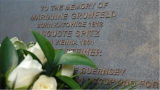 Flowers laid at Guernsey memorial for three Jewish women deported from the island during the German occupation in World War 2. Later all three died in Auschwitz