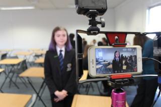 Girl being filmed on a smartphone