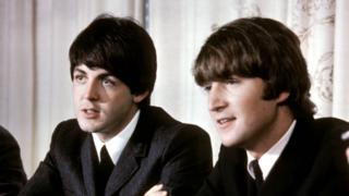 McCartney and Lennon at a press conference in 1965.