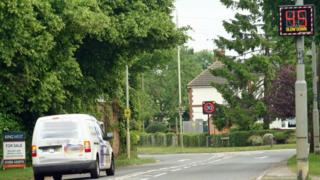 Coventry Road in Sharnford showing the STAG speed meter display and the fixed display Leicestershire County Council speed limit sign