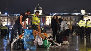 Protesters gather items as police remove Extinction Rebellion protesters from Trafalgar Square
