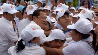 Hun Sen hugs supporters at a campaign rally on 7 July