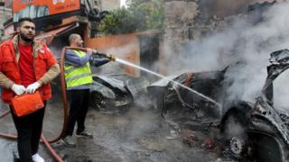 Lebanese fireman extinguishes fire in car of Palestinian Fatah official Fathi Zeidan following an explosion in southern port city of Sidon, Lebanon (12 April 2016)