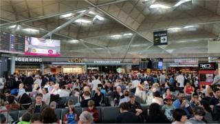 Passengers waiting at Stansted