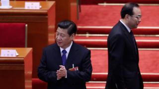 Communist Party Secretary of Chongqing Sun Zhengcai (R) walks behind Chinese President Xi Jinping (L) as they attending the fifth plenary meeting of the National People's Congress at the Great Hall of the People on 15 March 2013 in Beijing, Chin
