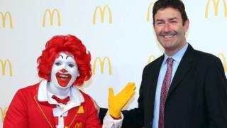 Steve Easterbrook, CEO McDonald's, poses with Ronald McDonald during the new McDonald's Flagship Restaurant re-opening at Frankfurt International Airport, Terminal 2, on 30 March 2015