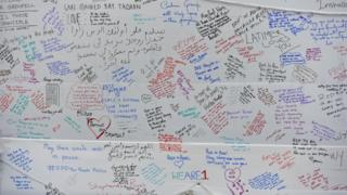 Messages of sorrow and solidarity on a wall
