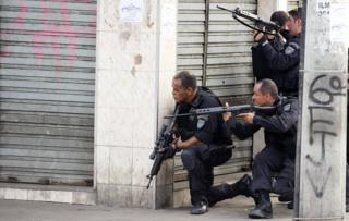 Riot agents hold their rifles at an entrance of Vila Cruzeiro shantytown in Rio de Janeiro, Brazil on 25 November, 2010