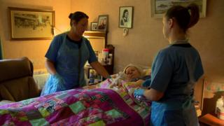Home care workers with a patient