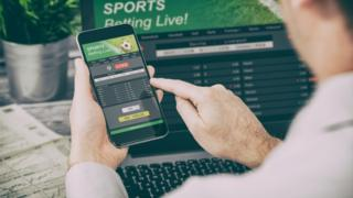 Images of man online gambling