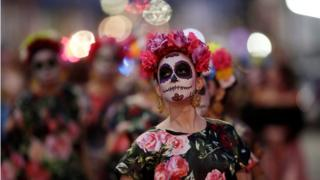 "A woman dressed as a ""Catrina"" takes part in a Catrina parade ahead of the Day of the Dead in Saltillo, in the state of Coahuila, Mexico, October 31, 2018."