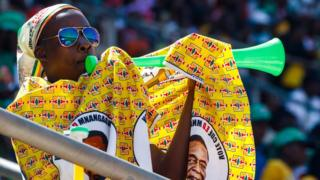 A man blows a vuvuzela during the official inauguration ceremony of President Emmerson Mnangagwa in Harare, Zimbabwe - Sunday 26 August 2018