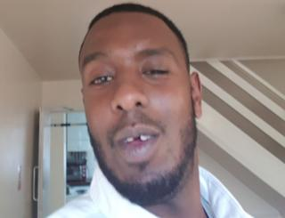 A selfie of Abdi Ali with his front gold tooth removed
