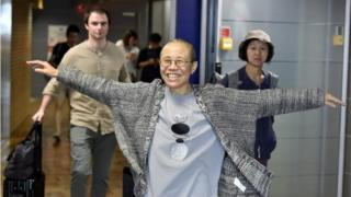 Liu Xia, the widow of Chinese Nobel Peace Prize-winning political dissident Liu Xiaobo, gestures as she arrives at the Helsinki International Airport in Vantaa, Finland, July 10, 2018.
