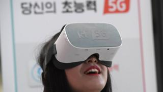 Woman uses 5G services on a virtual reality devices in Seoul in April 2019