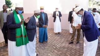Tanzania's Prime Minister Kaasim Majaaliwa being greeted outside the mosque