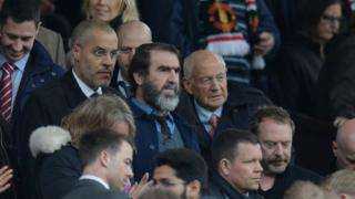Manchester United's French former player Eric Cantona (C) arrives to watch the English Premier League football match between Manchester United and Leicester City at Old Trafford