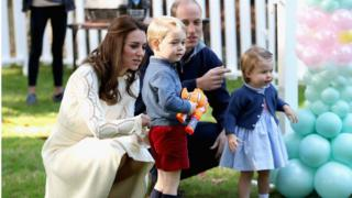 Catherine, Duchess of Cambridge, Princess Charlotte of Cambridge and Prince George of Cambridge, Prince William, Duke of Cambridge at a children's party