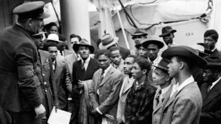 Jamaican men being welcomed by RAF officials after the Empire Windrush arrived at Tilbury on 22 June 1948