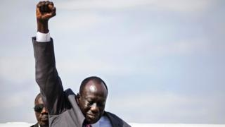 South Sudan's deputy rebel chief General Alfred Ladu Gore raises his fist as he arrives at the Juba international airport on 12 April 2016