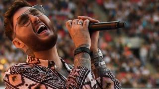 James Arthur performs on stage