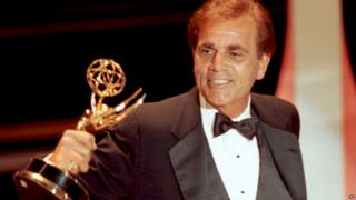 Actor Alex Rocco collects an Emmy in 1990