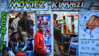 People at a barbershop in Nairobi, Kenya - Tuesday 31 March 2020