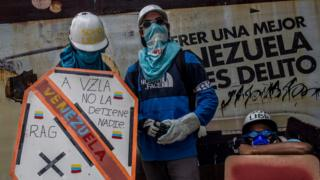 Two masked protesters known under the alias Los Pedros