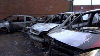 The burnt-out cars in Carrickfergus