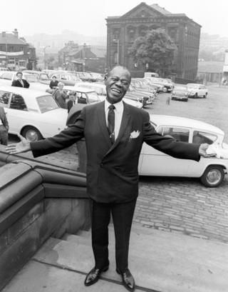 American jazz trumpeter and singer Louis Armstrong in Batley market square in June 1968