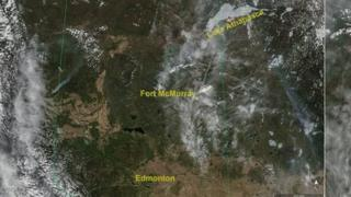 A satellite image of the Alberta wildfire shared by Chris Hadfield
