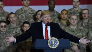 US President Donald Trump speaks to the troops during a surprise Thanksgiving day visit to Afghanistan