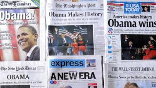 Front pages of newspapers announcing Democrat Barack Obama's victory in the US 2008 presidential election are displayed in Washington, DC.