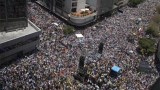 Thousands of demonstrators protesting against President Nicolas Mauro's government march in Caracas on April 8, 2017.