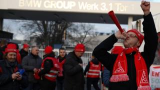 BMW workers during a 24-hour strike by German industrial trade union IG Metall in Berlin