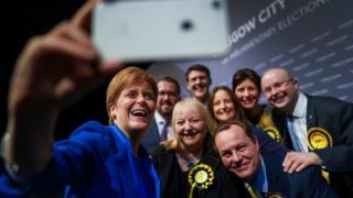First Minister Nicola Sturgeon takes a selfie with some of her newly elected MPs at the Glasgow count