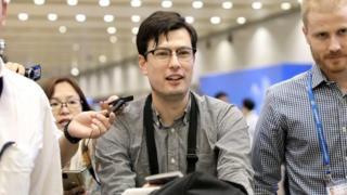Alek Sigley at the airport