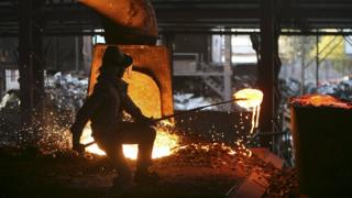 A labourer works inside a steel factory on the outskirts of Jammu, India