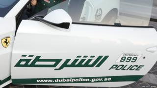 An Emirati female police officer poses sitting in a Ferrari police vehicle on April 25, 2013 in the Gulf emirate of Dubai
