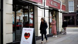 Customers follow social distancing outside a Pret